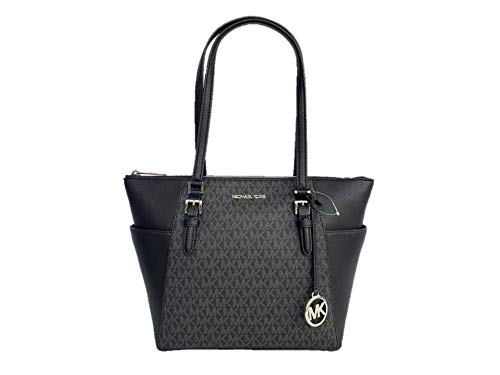 """Logo print coated canvas (PVC) with smooth leather trim and silver hardware. Top-zip closure. Exterior features two side slip pockets and MK logo charm. Double leather shoulder straps with 10"""" drop. Interior: Logo lining; one zip pocket and two multi..."""