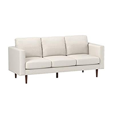 """Amazon Brand – Rivet Revolve Modern Upholstered Sofa Couch, 80""""W, Linen - This modern sofa features simple lines and square armrests atop tall tapered legs, giving it a minimalist feel that looks great with most decor styles. 79.9""""W x 34.6""""D x 35.4""""H Hardwood frame, solid beech wood legs and durable polyester upholstery stand up to wear and tear - sofas-couches, living-room-furniture, living-room - 31CBu89NCaL. SS400  -"""