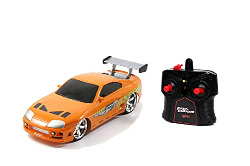 Jada Toys Fast & Furious RC Auto Brian's Toyota Supra, ferngesteuertes Auto mit 2-Kanal Funksteuerung, Turbofunktion, fährt vorwärts-rückwärts, links-rechts, Maßstab 1:24, ab 6 Jahren, orange