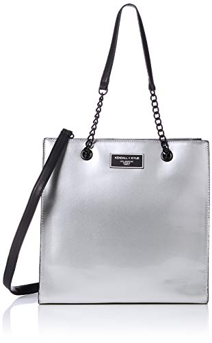 The everyday classic tote with two great colorways, your perfect grab and go bag! Snap closure with chain detailing on the shoulder strap and crossbody strap included