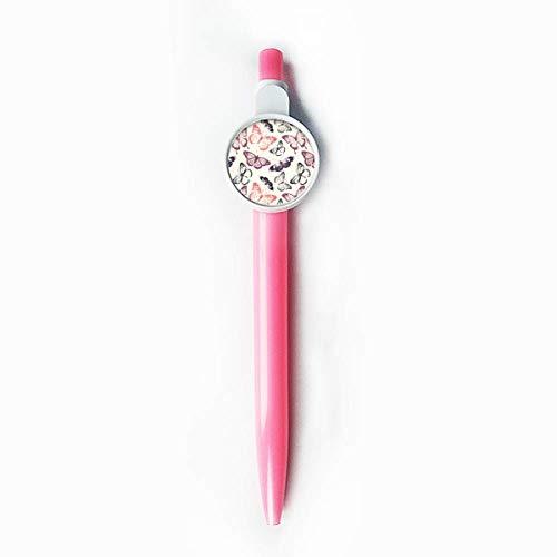 Borboleta em fundo rosa pálido ponta esferográfica azul retrátil caneta escrevendo papelaria
