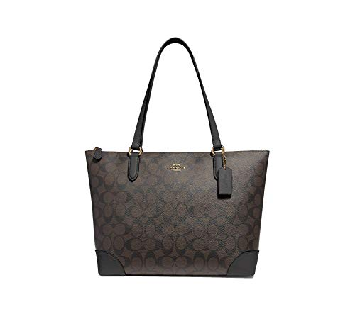 "Signature jacquard with smooth leather details Interior: three multifunction slip pockets Zip-top closure, fabric lining Handles with 8 3/4"" drop Size Approx. 10 1/2"" (L) x 10 1/4"" (H) x 4 1/4"" (W)"
