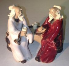 Bonsai Boy's Ceramic Figurine Two Men Sitting On A Bench Color: White & Red