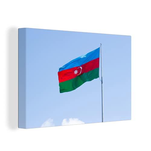 Leinwandbild - Die Flagge von Aserbaidschan weht am blauen Himmel - 150x100 cm