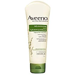 Travel size bottle of Aveeno lotion for face and body. The best solo female travel gear.