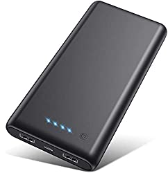 A black portable battery pack for charging devices while traveling.