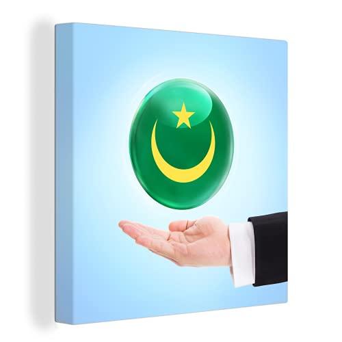 Leinwandbild - Die Flagge von Mauretanien schwebt über einer Hand - 90x90 cm