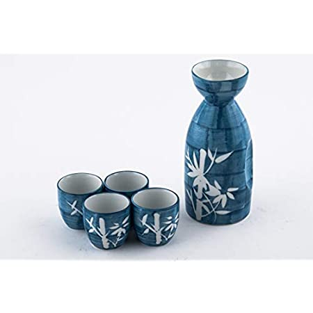 vintage sake cups Set of 4 white and blue ceramic Japanese tea or saki cups marked Lhong Tao  ribbd tea cups white with blue leafy flowers