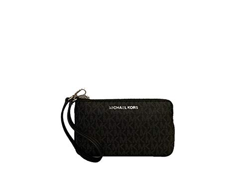"""MK Signature coated canvas with leather trim and silver-tone hardware. Zip top closure. Michael Kors logo lettering. Leather wrist strap, 6""""drop. Interior: Fabric logo lining; 3 card slots. Approximate dimensions: 7-1/4""""L x 4-1/4""""H x 1/2""""D."""