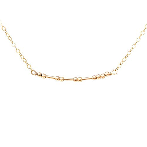 A gold necklace with a cool secret