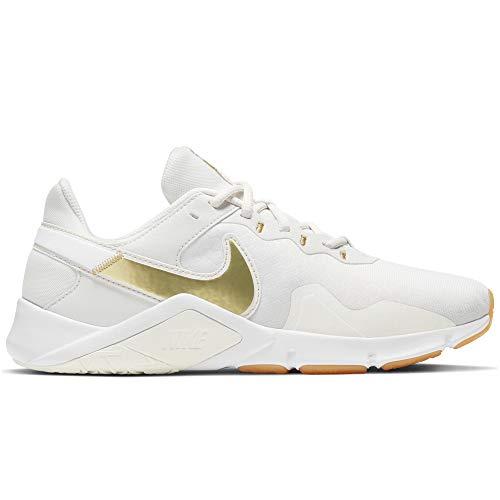 Nike Wmns Legend Essential 2, Zapatos de Entrenamiento Mujer, Platinum Tint/MTLC Gold Star, 40 EU
