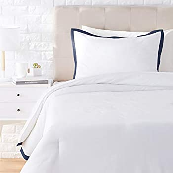 white comforter with navy trim
