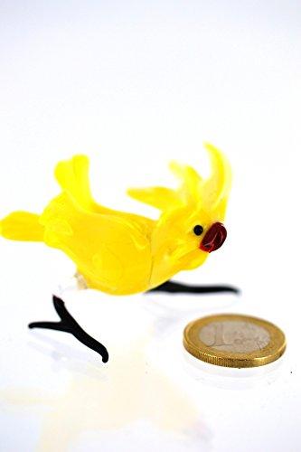 Deko-Shop-Hannusch Décoration en verre à poser sur pieds en forme d'oiseau en forme de perroquet Jaune