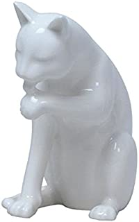 US 5.5 Inch All White Porcelain Cat Sitting and Licking Left Paw