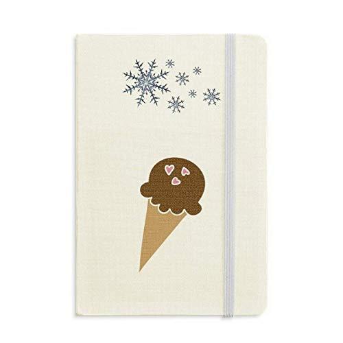 Cuaderno de chocolate con cacahuete y helado grueso con copos de nieve de invierno