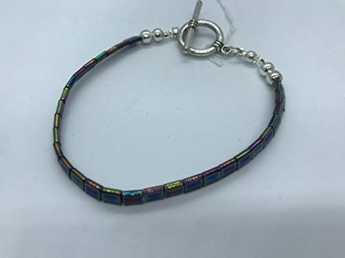 Iridescent blue flat beads bracelet very light with toggle clasp and silver metal spacer beads handmade by Susan Craker