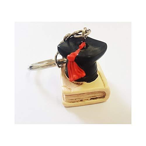TrAdE Shop Traesio 12 Pezzi BOMBONIERA PORTACHIAVE Cappello Libro Laurea Simbolo Fortuna Ceramica