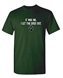 "Green graphic t-shirt with the words ""It was me I let the dogs out"" and a paw print on the front."