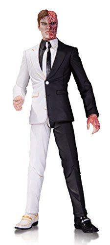 """Based on Greg Apollo's designs from the best-selling DC Comics hit Batman Recreates Batman's gruesome enemy Two-Face Figure stands 6.6"""" H Outstanding detail Limited edition"""