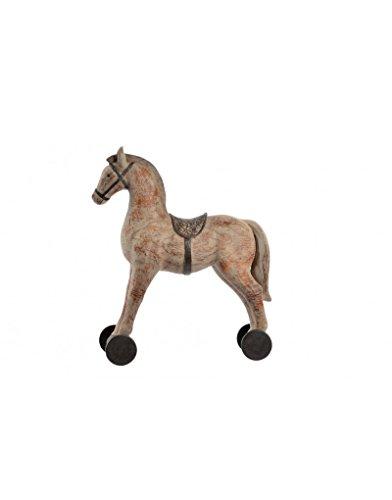 Huis en meer – paard op wielen van metaal voor decoratie thuis.