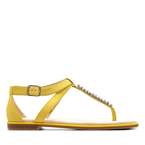 Sandalias amarillas planas con elegante diseño