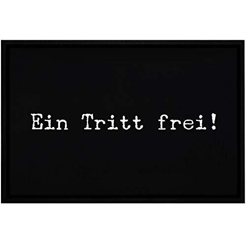 MoonWorks® Felpudo con texto en alemán divertido «EIN Tritt frei ironisch sarcastisch antideslizante & lavable blanco 60 x 40 cm