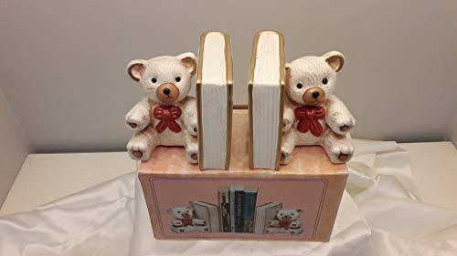 1 paar boekensteunen van keramiek met gesorteerde motieven (hond, beertje, kat), afmetingen: 12 x 23 x 11,5 cm