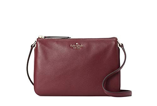 """Kate Spade New York pebble leather with gold tone hardware Raised Kate Spade New York name and logo on front Crossbody, shoulder strap with adjustable drop of 19-23"""" Interior features two way Spade jacquard fabric lining; three interior compartments ..."""
