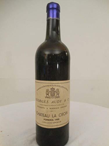 pomerol château la croix rouge 1955 - bordeaux france: une bouteille de vin.