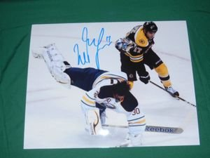 Boston Bruins Milan Lucic Autographed 8x10 Hitting Ryan Miller Photo