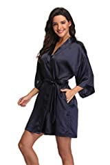 Light and sleek fabric to accentuate curves; Smooth to the touch and easy on the skin. Featuring kimono oblique V neck,half sleeves,side pockets. Inside ties to keep the robe closed and exterior matching belt to keep firmly. Solid color tone kimono r...