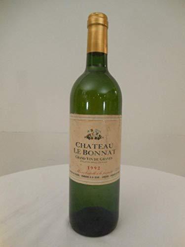 graves château le bonnat blanc 1992 - bordeaux france: une bouteille de vin.