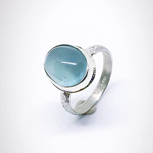 Precioso anillo con preciosa Aguamarina en cabujón de dimensiones (12 mm x 8 mm). Anillo en Plata de ley. Anillo con Aguamarina de altísima calidad.