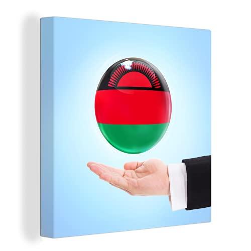 Leinwandbild - Die Flagge von Malawi schwebt über einer Hand - 20x20 cm