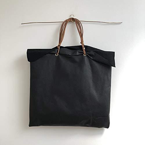 Bolso negro gigante de piel con solapas, pieza única
