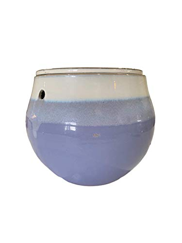 ceramic planter with purple on the bottom and cream on top.