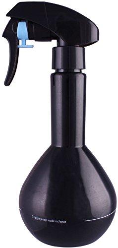 Une bouteille en plastique pulvérisateur, brumisateur. Pour salon de coiffure. 200 ml.