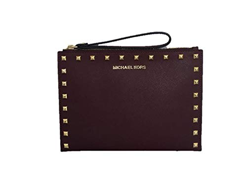 "Studded Genuine Saffiano leather with Golden-Tone Hardware Top Zip Closure; Fully Lined INTERIOR: 1 Slip Pocket, 6 Card Slots 7"" wrist strap 9.5""L x 6.75""H"