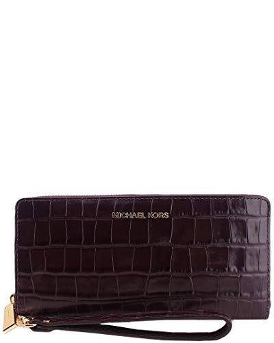 Made of saffiano leather. Zip around closure. Removable wristlet strap. Lined interior features zip pocket, currency compartment and card slots. Measurements: Bottom Width: 8 in Depth: 1 in Height: 4 in Handle Length: 11 in Handle Drop: 5 1⁄2 in Weig...
