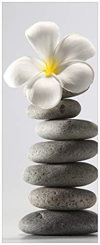 Wallario Acrylglasbild Blume auf gestapelten Steinen - 50 x 125 cm in Premium-Qualität: Brillante Farben, freischwebende Optik