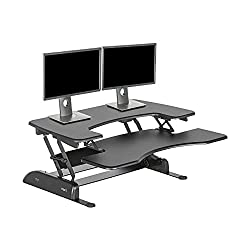 This adjustable standing desk, available from Amazon, is the best there is.