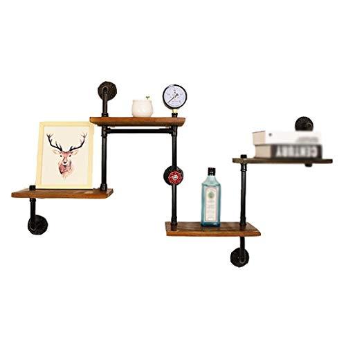 Plank, ouderwetse opbergrek, ijzeren boekenplank in industriële stijl, aan de muur bevestigd waterpijprek aan de muur van de woonkamer
