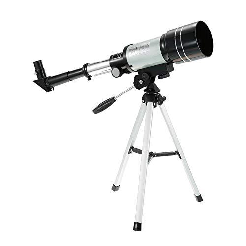 Telescopio astronómico, con un trípode refractante...