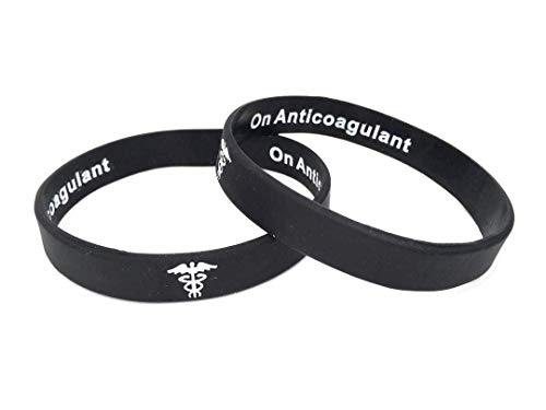 On Anticoagulant hidden message pulsera de silicona para alerta médica de emergencia. En blanco y negro pulsera con texto en inglés. 202mm. By Butler & Grace