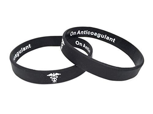 On Anticoagulant hidden message pulsera de silicona para alerta médica de emergencia. En blanco y negro pulsera con texto en inglés. 202mm. By Butler & Grace