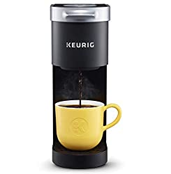 Keurig K-Mini coffee maker with yellow coffee cup is one of the best gifts for freelancers