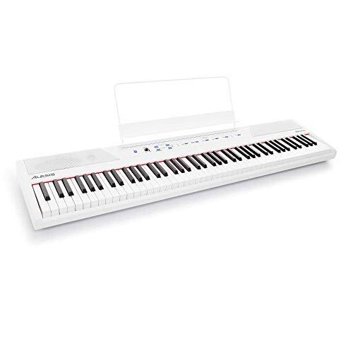Alesis Recital White - 88-Tasten Einsteiger Digital Piano / E Keyboard mit halbgewichteten Tasten,eingebauten 20 Watt Lautsprechern und fünf Premium-Stimmen, 3-Monatsabo Skoove, Weiß