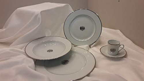 Christofle Set Posto tavola 4pz: 1 Piano cm26-1 Fondo cm 23.5-1 Frutta cm 21-1 Tazza caffè con piattino. MOD. Wakame Platino