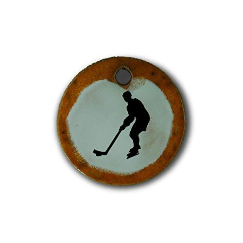 """Muy bonito colgante de cerámica """"hockey sobre hielo"""" jaspeado en naranja;"""