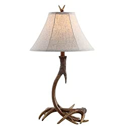 A rustic antler lamp with lamp shade